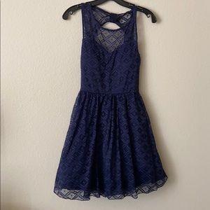 Blue lace semi-formal dress. Open back.